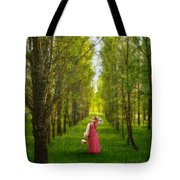 Woman In Vintage Pink Dress Walking Through Woods Tote Bag