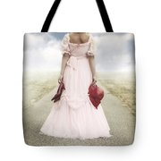 Woman On A Street Tote Bag