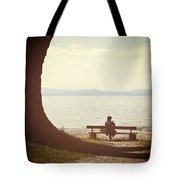 Woman On The Shore Of A Lake Tote Bag