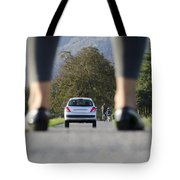 Woman Standing On A Road Tote Bag