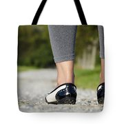 Woman Standing On A Stone Road Tote Bag
