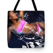 Woman Wearing Bikini Lying In Water Tote Bag