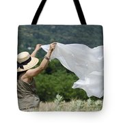 Woman With A White Sheet Tote Bag