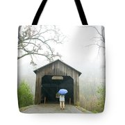 Woman With Umbrella In Front Of Covered Tote Bag