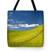 Wooden Fence Posts Running Through A Tote Bag