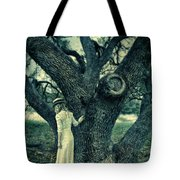 Young Lady In White By Tree Tote Bag