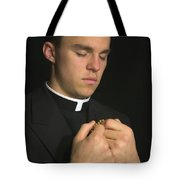 Young Priest Praying With Rosery Tote Bag