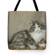 A Kitten On A Table Tote Bag