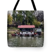 A Raft House Moored To The Shoreline Of Ada Medjica Islet Tote Bag