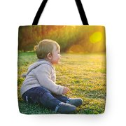 Adorable Baby Playing Outdoors Tote Bag