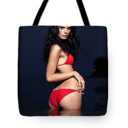 Beautiful Young Woman In Red Swimsuit Standing In Water Tote Bag