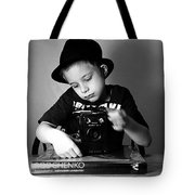 Boy In Hat With Old Camera. Tote Bag