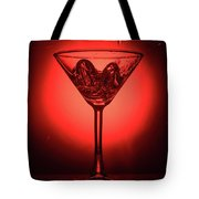 Cocktail Glass With Splashes On Red Background Tote Bag