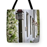 Colonial Home Exterior With Vertical Plants And Old Lanterns Displayed On The Side Of Home Tote Bag