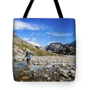 Crossing A River In Patagonia Tote Bag