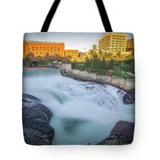 Falls And The Washington Water Power Building Along The Spokane  Tote Bag