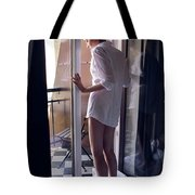 Girl In The Shirt Stands At The Balcony In The Morning Tote Bag