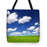 Green Rolling Hills Under Blue Sky Tote Bag by Elena Elisseeva