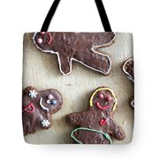 Handmade Decorated Gingerbread People Lying On Wooden Table Tote Bag