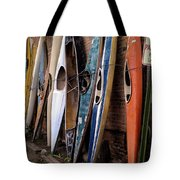 Kayaks Lined Up On Wall Tote Bag