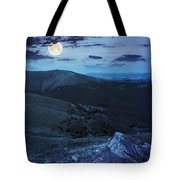 Light On Stone Mountain Slope With Forest At Night Tote Bag