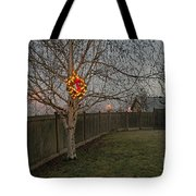 Lit Christmas Wreath Hanging In Tree Tote Bag