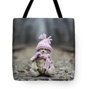Little Teddy Bear Sitting In Knitted Scarf And Cap In The Winter Forest Between The Rails Tote Bag