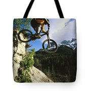 Man Jumping On His Mountain Bike Tote Bag