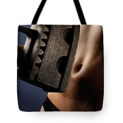 Naked Woman With An Old Heavy Iron Tote Bag