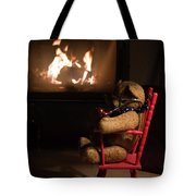 Old Teddy Bear Sitting Front Of The Fireplace In A Cold Night Tote Bag