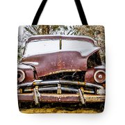 Old Vintage Plymouth Automobile In The Woods Covered In Snow Tote Bag
