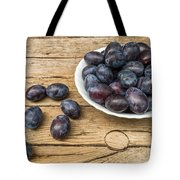 Plate Full Of Fresh Plums On A Wooden Background Tote Bag