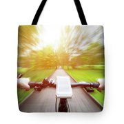 Riding A Bike First Person Perspective. Smartphone On Handlebar. Speed Motion Blur Tote Bag