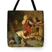 Three Children Feeding Rabbits Tote Bag