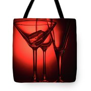 Three Empty Cocktail Glasses On Red Background Tote Bag