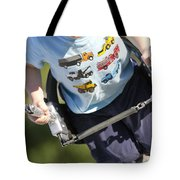 Young Boy Smiling Swinging In A Swing Tote Bag