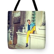 Young Man Relaxing On Street Tote Bag
