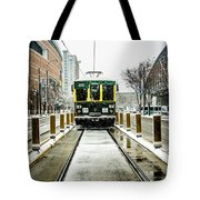 Streetcar Waiting For Passengers In Snowstrom In Uptown Charlott Tote Bag