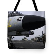 An F-14d Tomcat On The Flight Deck Tote Bag by Gert Kromhout