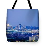 Buildings In A City Lit Up At Dusk Tote Bag