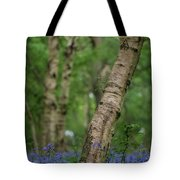 Shallow Depth Of Field Landscape Of Vibrant Bluebell Woods In Sp Tote Bag