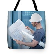 Architect Builder Studying Layout Plan Of The Room Tote Bag