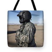 Crew Chief Of A Ch-47 Chinook Stands Tote Bag