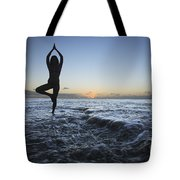 Female Doing Yoga At Sunset Tote Bag