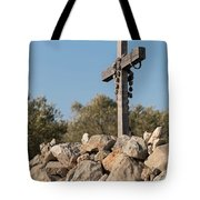 Rosary Hanging On A Small Wooden Cross On A Stone Wall Tote Bag