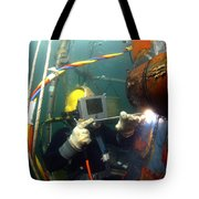 U.s. Navy Diver Welds A Repair Patch Tote Bag by Stocktrek Images