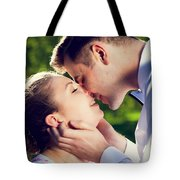 Young Romantic Couple Kissing With Love In Summer Park Tote Bag