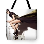 Young Woman In Long Dress On Exercise Bike Tote Bag