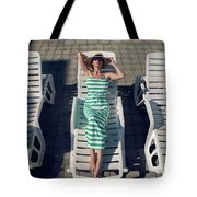 Girl Lies On A Chaise Longue In A Green Striped Dress Tote Bag