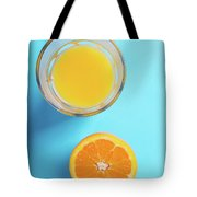 Glass Of Orange Juice And Half Of Orange Tote Bag